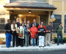 Families celebrate new homes at the ribbon cutting at Temple Street condominiums.