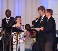 Rev. Rick Smith, Kabby Akers, Rev. Adam Jones and Lexington Mayor Jim Gray at BUILD's 2014 Nehemiah Action