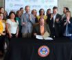 Advocates cheer on Governor Polis as he signs the historic bill package that includes dedicated revenue for affordable homes